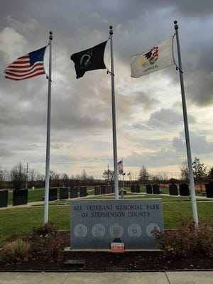 Flags honoring the branches of the military service greet visitors to All Veterans Memorial Park in Freeport.