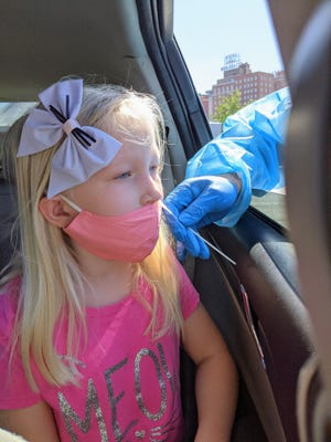 The fastest way for Lucinda Slaughter, 8, to get back into school after showing mild symptoms of COVID-19 was to get a drive-through test at the Civic Center parking.