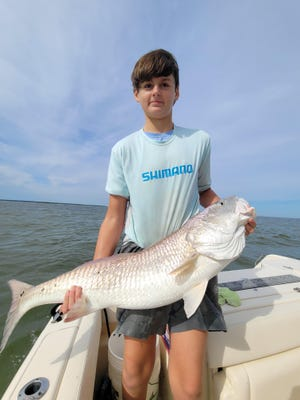 Tillman Clark, 14, of Savannah, caught and released this bull red (and 17 more within a two-hour time period) near Delegal Marina, with the help of Captain Mike Womble, Director of Outdoor Pursuits at The Ford Plantation in Richmond Hill.
