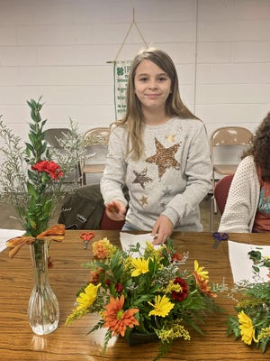 Gwen Stark, member of the Happy Handful 4-H Club in Mason County, participated in a floral workshop this past fall. 4-H alumnus, Tami Davidage taught the workshop as a way to encourage the young participants to learn new skills and hopefully create an interest in a new hobby or even future career.