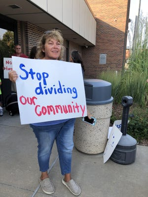 "Jenifer Kraus, of Hays, was among the dozen or so protesters outside city hall Thursday evening. ""I hope there's a good outcome,"" she said. ""If it's God's will that it's going to happen, then it's going to happen."""