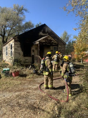 Wellington firefighters put out a fire at a home at 410 N. Park St.