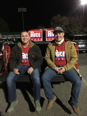 Donald Rice, left, relaxes on the tail of a pickup truck after Election Day campaigning with his campaign treasurer Holden Clark. Rice, a current Cramerton commissioner and assistant district attorney, won election to the District Court bench, ousting incumbent Democrat Richard Abernethy.