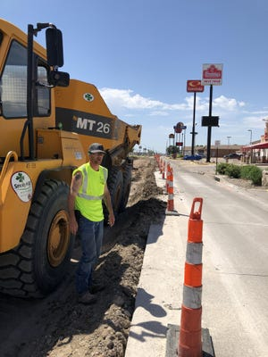 Smoky Hill construction worker Henry Cole, of Salina, was halfway through lunch break about noon Thursday on N. Vine Street, where the west frontage road is down to one northbound lane.
