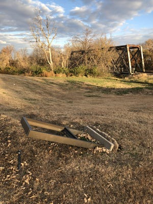 A downed historical plaque telling the history of Hangman's Bridge was knocked over in early November 2018 and the plaque taken, leaving its whereabouts a mystery.