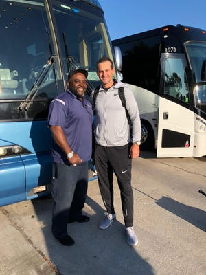 Champion Bus driver, and UGA Football fan, James Winston pictured with New York Yankees manager Brett Boone.