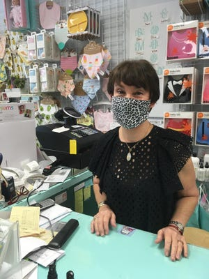 Linda Karpf at Punch and Judy is a proponent of masks but has been reluctant to confront unmasked customers.
