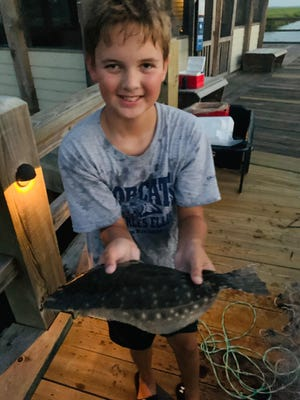 Ian Perry, 11, of Savannah, caught this flounder at The Landings' marina on Skidaway Island on Sept. 4 with cast net while fishing with his friend Wyatt Jarman and Wyatt's dad, Alex Jarman.