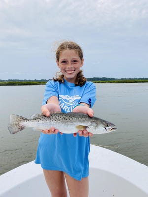 Maddie Shively, 11, of Savannah caught this trout on Sept. 19 in Freedom Creek. She also caught a second, smaller trout and missed a few other bites, but she out-fished both her mother Rachel Bolton and her mother's boyfriend Austin Paige.