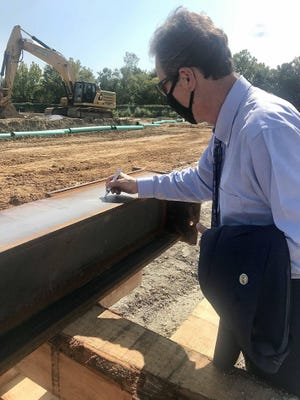 City Manager Pat Monahan, the mayor, and most of city council signed a steel beam for the new arena on Sept. 1, 2020. (DeAnn Komanecky/savannahnow.com