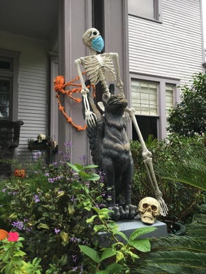 A Washington Avenue skeleton is masked up -- but not covering its nose! -- to greet trick-or-treaters. Mary Landers/Savannahnow.com