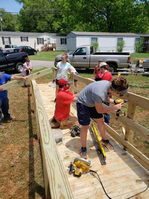 A group from Althama/New Sunbury Association, Georgia, replaced a roof for Coleman Wilson.