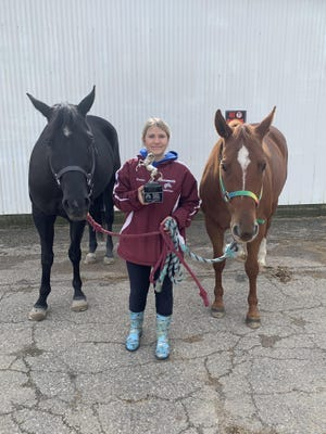 Morenci senior Carollyn Davis stands with her horses Sheeba and Jack after competing in the Michigan Interschollastic Horsemanship Assocation regional competition earlier this year.
