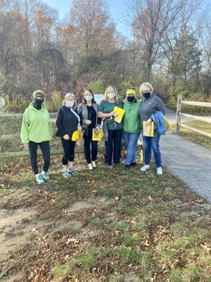 A group of walkers from Howard Hanna Realty Group poses for a photo at Saturday's Walk for Warmth. Hosted by the Monroe County Opportunity Program, this was the 30th anniversary of the annual fundraiser.