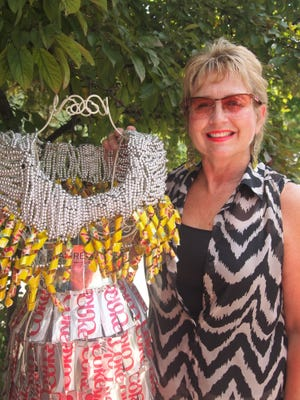 Colleen Chertos with a dress she created with beads and recycled aluminum cans.
