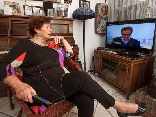 Benedicte Brown keeps up with news from her hometown