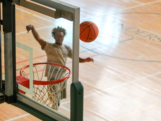 Ty Cobb plays basketball at the Anderson Recreation Center on Tuesday.