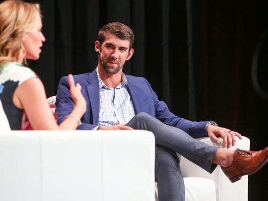 Michael Phelps talks with Alex Flanagan at the Barbara Sinatra Champions Honor Luncheon in Rancho Mirage, March 3, 2017.
