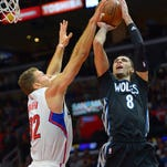 Los Angeles Clippers forward Blake Griffin (32) defends a shot by Minnesota Timberwolves guard Zach LaVine (8) in the first half of the game at Staples Center.