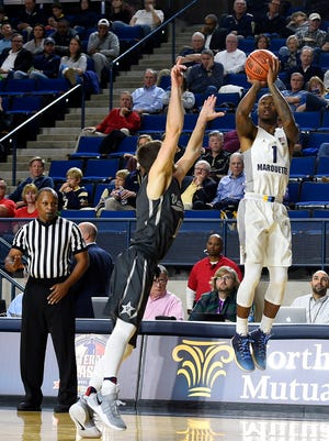 Duane Wilson (1) takes a three-point shot over  Camron Justice of Vanderbilt.