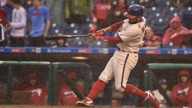 Philadelphia Phillies second baseman Andres Blanco flies out to center field to end the game against the Atlanta Braves at Citizens Bank Park. The Phillies managed only two hits in a 2-0 loss to the Braves and have not scored a run in 17 innings.