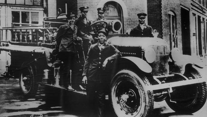 Black firemen pose with a Stutz fire engine in front of Station 1 on Indiana Avenue in 1926.