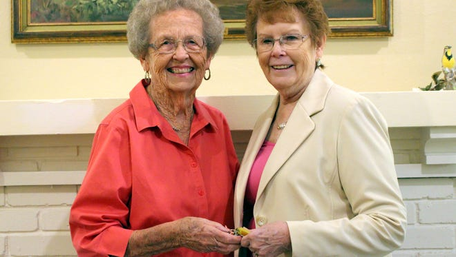 Longtime volunteer and Museum Director Virginia Poole, left, hands the key down to the newly appointed director Suzanne Stewart. Stewart is a former resident who has returned to embrace and share the history of her hometown.