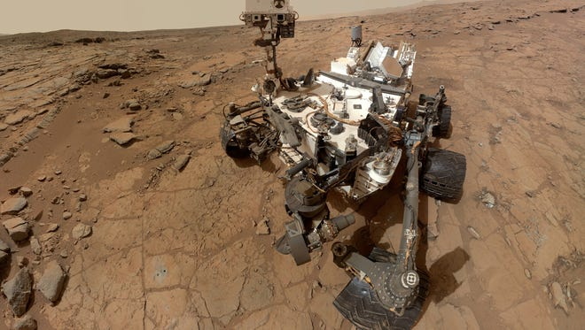 This photo released by NASA shows a self-portrait taken by the NASA rover Curiosity in Gale Crater on Mars.