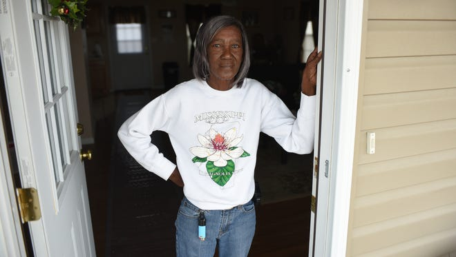Jean Abram, 70, stands in the doorway of her new house that Columbia Strong volunteers rebuilt after she lost her home to the 2014 Columbia tornado.