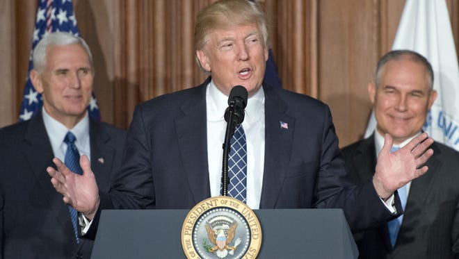 President Trump, joined by Vice President Pence and Environmental Protection Agency Administrator Scott Pruitt, makes remarks prior to signing an energy independence executive order at EPA headquarters on March 28, 2017.