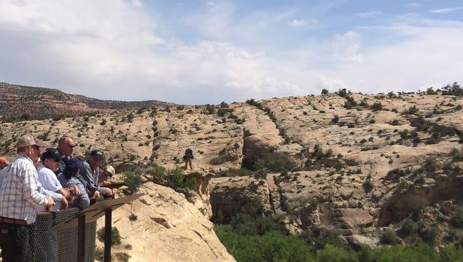 Interior Secretary Ryan Zinke, hatless and wearing sunglasses, looks at ancient native ruins in Bears Ears National Monument, Utah. (William Yardley/Los Angeles Times/TNS)