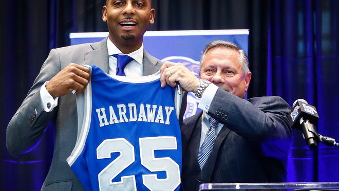"""Anfernee """"Penny"""" Hardaway holds up his old jersey with AD Tom Bowen (right) while being introduced as the University of Memphis' new head basketball coach at the Laurie-Walton Family Basketball Center Tuesday morning. Hardaway, who a standout player at the U of M from 91-93, will take over for recently fired head coach Tubby Smith."""