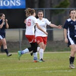 Evangel's Autumn Shimer congratulates Caitlin Cantrell on her second half goal against Lafayette Christian Academy.