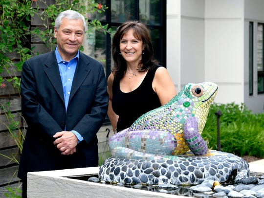 Mike Shmerling, who founded the Abe's Garden in memory of his dad, who died of Alzheimer's and his sister, Judy Given,who works as director of campus development at Abe's Garden, stand together in the facility's courtyard and garden on June 19, 2018.   Abe's Garden is a Nashville memory care facility serving people with Alzheimer's.