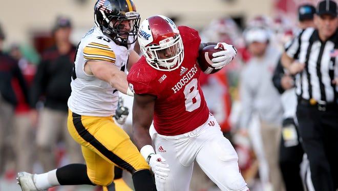 Hoosiers running back Jordan Howard (8)  ran for this touchdown Nov. 7 against Iowa, but hasn't played since suffering a knee injury Nov. 21.
