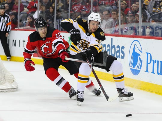 Boston Bruins defenseman Matt Grzelcyk (48) and New