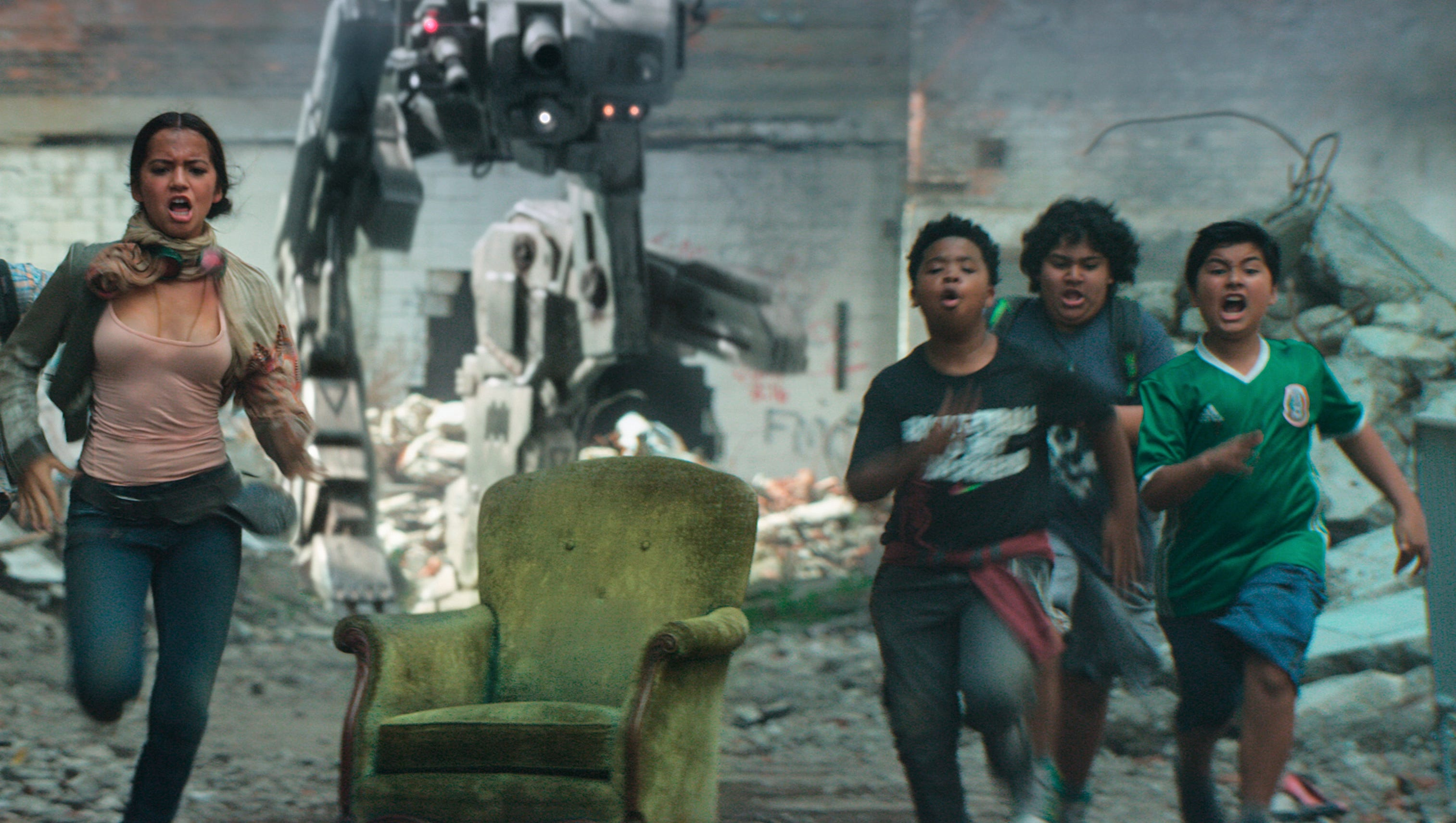 """Benjamin """"Lil P-Nut"""" Flores Jr. (third from left) tries to outrun a robot in """"Transformers: The Last Knight."""" He"""