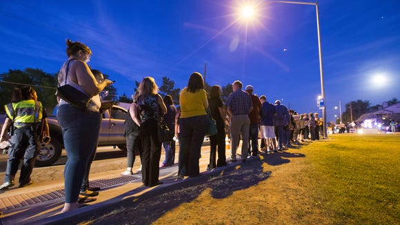 Voters wait in line to cast ballots. But, why bother?