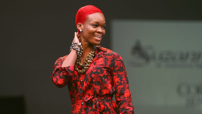 A model shows clothing from Suzanne's Distinctive Fashions during the Fashion 9 to 5 Show that is part of Fashion Week