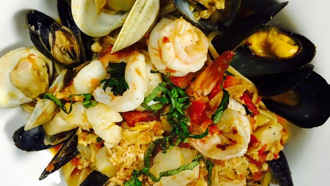 Shrimp, mussels and calamari rest atop linguine at Gusto Cucina Italiana, new to Cape Coral.
