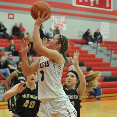 Jenna Karl drives to the hoop to put up a shot against