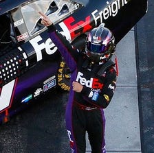 Denny Hamlin does his best Babe Ruth impersonation after winning at New Hampshire Motor Speedway in 2012.