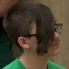 16-year-old Blue Kalmbach sits in court.