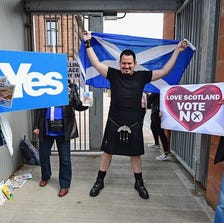 Felipe Perez brandishes a Scottish flag as he leaves a polling station at Notre Dame primary school on Sept. 18 in Glasgow. People are voting on an independence referendum that could break up the centuries-old United Kingdom and create Europe's newest state.
