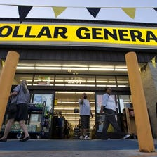 In this Sept. 25, 2013, file photo customers exit a Dollar General store, in San Antonio.
