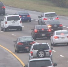 Vehicles travel on a Knoxville interstate