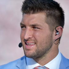 Tim Tebow of the SEC Newtork on the field before a game between the South Carolina Gamecocks and the Texas A&M Aggies at Williams-Brice Stadium on August 28, 2014 in Columbia, South Carolina.