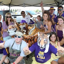 Aug 31, 2013; Arlington, TX, USA; The McGee tailgate party poses for a photo with their LSU Tigers prior to the game against Texas Christian at AT&T Stadium. Mandatory Credit: Matthew Emmons-USA TODAY Sports