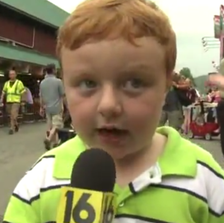 Noah Ritter, a 5-year-old from Wilkes-Barre, Pa., takes the mic at a county fair.