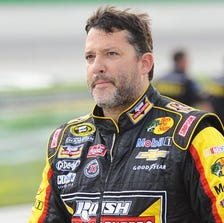 NASCAR Sprint Cup Series driver Tony Stewart (14) after his qualifying run for the Quaker State 400 at Kentucky Speedway.